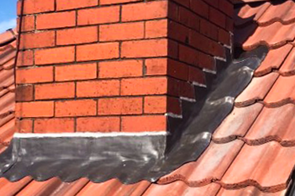 Lead work on roof chimney