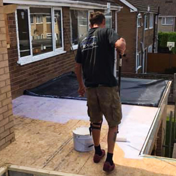 Ridgeline Roofing laying Flat Roof